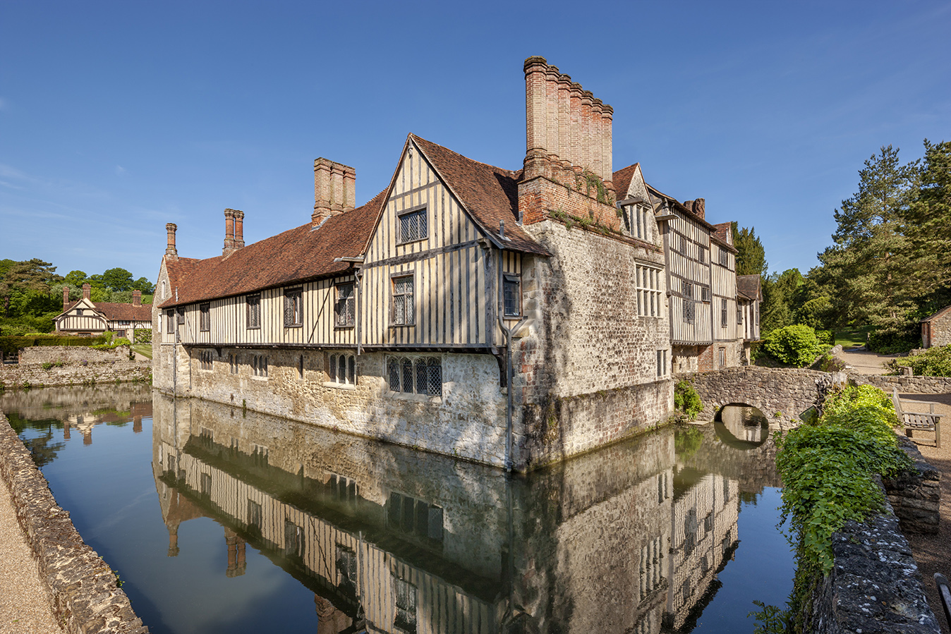 The south east corner with the cottages in the background at Ightham Mote estate, Kent. National Trust_Andrew Butler