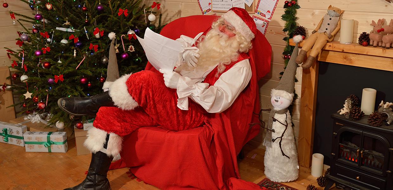 Father Christmas checking list in cabin, Calverley Grounds, Royal Tunbridge Wells, credit: Darryl Curcher