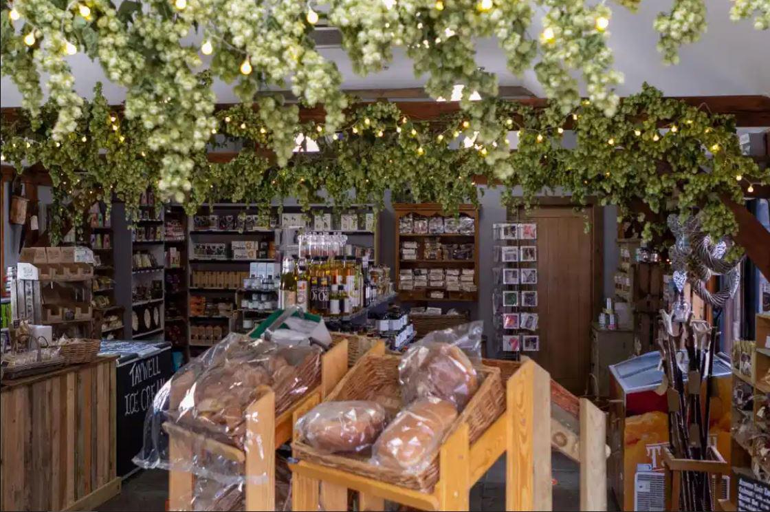 Taywell Farm shop interior including produce, bread, hop plants