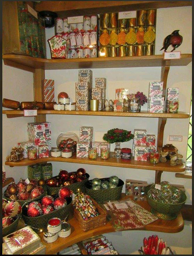 Display of Christmas gifts and decorations at the Pashley Manor Christmas Shop